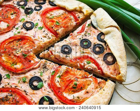Savory Puff Pastry Pizza Pie With Ricotta Cheese, Fresh Tomatoes, Black Olives And Parsley, Selectiv