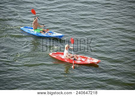Aerial View of Young Happy Couple Paddling Kayaks on the Beautiful River or Lake