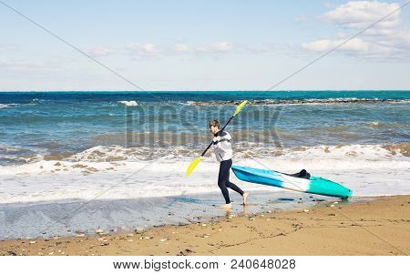 Summer Water Sport. Handsome Athletic Man With Sexy Body In Swimwear Holding Canoe Kayak Paddle. Bea