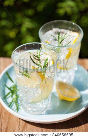 refreshing lemonade drink with rosemary in glasses