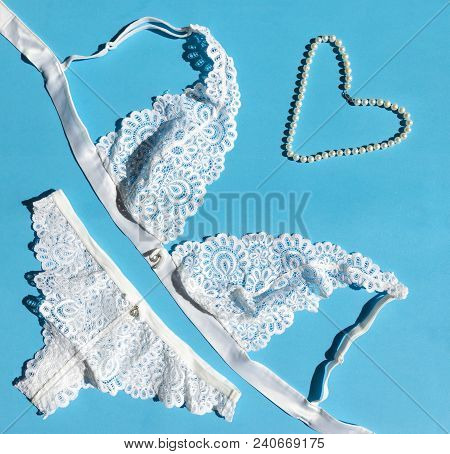 Lace White Lingerie, Panties, Bra, Pearl Necklace On Blue Background, Lingerie, Still Life, Flatlay