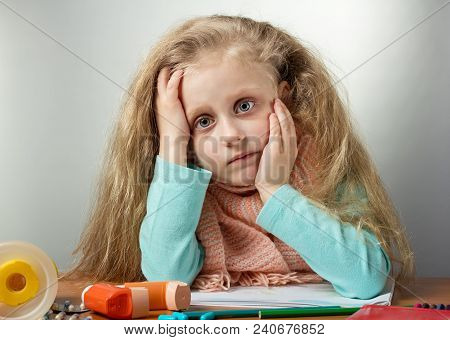 Sad Sick Girl With Warm Scarf Sitting At Table, Next To Medicine And Inhaler