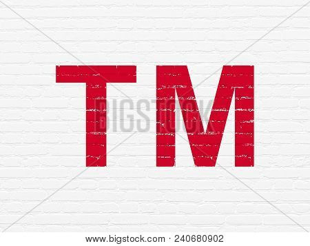 Law Concept: Painted Red Trademark Icon On White Brick Wall Background