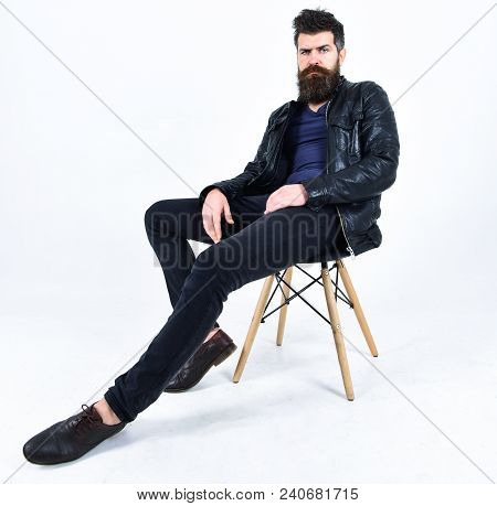Man With Beard And Mustache On Strict Face Looks At Camera. Menswear And Fashion Concept. Hipster Lo