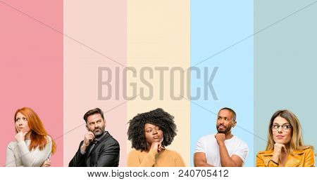 Cool group of people, woman and man thinking thoughtful with smart face