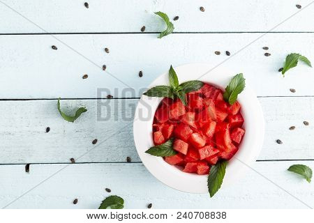 Table Top Shot Of A Bowl Of Watermelon Pieces On A Light Blue Rustic Background Decorated With Water