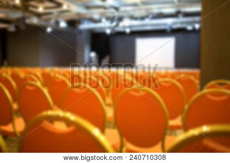 Blurred Empty Auditorium In Orange Colors Indoors