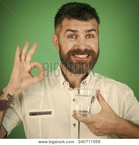Happy Hipster Drink Clean Healthy Water With Ok Gesture, Refreshing. Man With Long Beard Hold Water