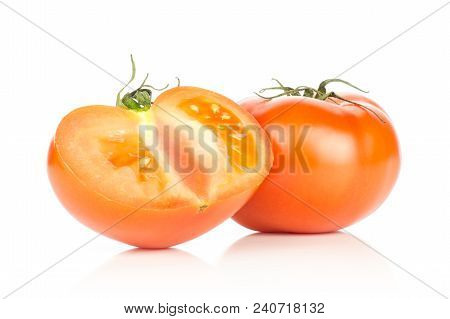 One Red Tomato And One Sliced Section Half Isolated On White Background