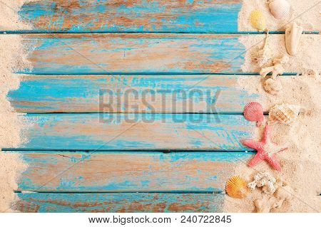 Beach Background - Top View Of Beach Sand With Shells, Starfish On Wood Plank In Blue Sea Paint Colo