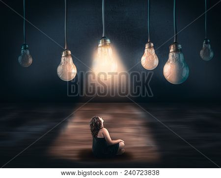Girl Looks Up To Plenty Of Lightbulbs And Only One Is Lit. The Concept Of Choosing The Right Opportu