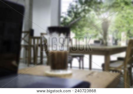 Desk Of Startup Coworking Business Office With Iced Drink, Stock Photo