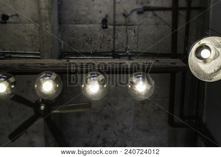 Light Bulbs Hanging From Ceiling, Stock Photo