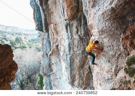 A Man Climbs The Rock. Climbing In Nature. Fitness Outdoors. Active Lifestyle. Extreme Sports. The A