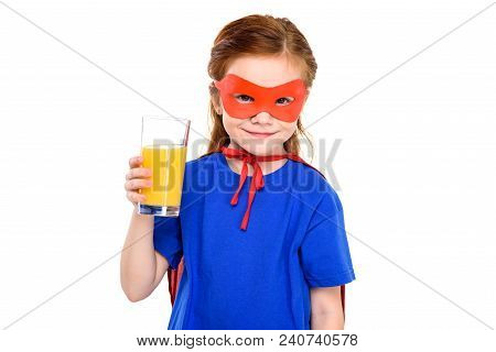 Adorable Super Child Holding Glass Of Juice And Smiling At Camera Isolated On White