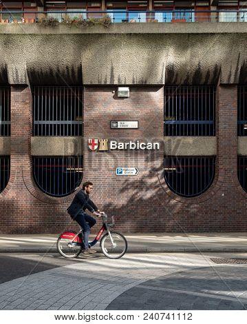 London, Uk - 26 April 2018: A Cyclist On A London Hire Bike Rides Past The Iconic Brutalist Architec