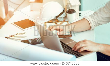 Close Up Portrait Of Civil Engineer Using Laptop To  Planning Project Schedule., Engineering And Con