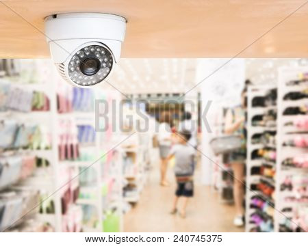 Cctv System Security Inside Of Stationery Store.surveillance Camera Installed On Ceiling To Monitor