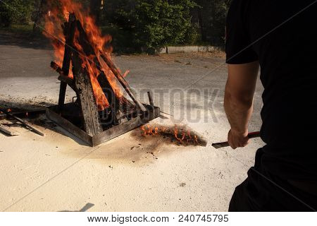 Training To Use A Fire Extinguisher Man Holding A Powder Type Fire Extinguisher Pointed Ahead Of His