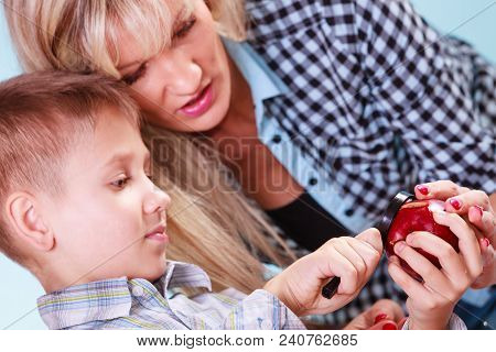 Early Education Nature And Biology. Mother Help Son Examine Fruit Apple With Magnifying Glass. Teach