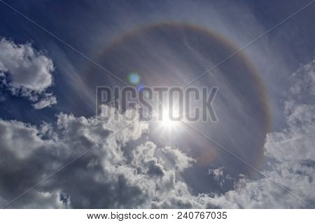 Halo Sun Ring. Halos Are Atmospheric Phenomena Created By Light Which Is Reflected Or Refracted By I