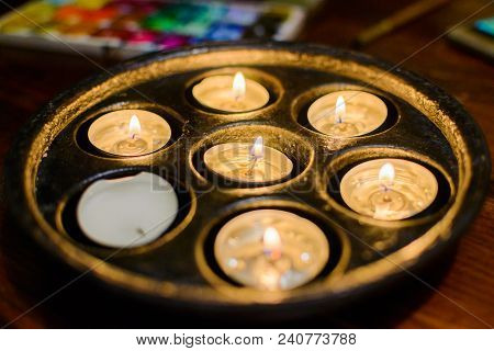 Burning Candles. Shallow Depth Of Field. Many Christmas Candles Burning At Night. Many Candle Flames