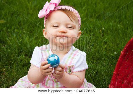 Easter Baby Hold Egg Smirk