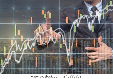Businessman Pointing Or Touching The Trading Graph Of Stock Market On The Virtual Screen On Photo Bl
