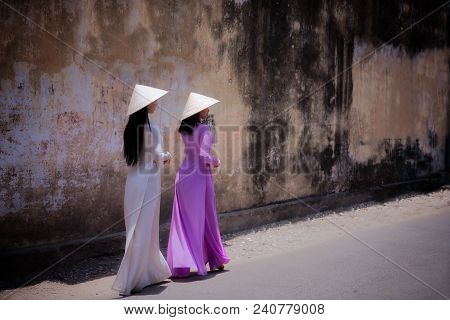 Vietnam Woman Wearing Ao Dai Culture Traditional Walking On Local Street At Ho Chi Minh In Vietnam,v