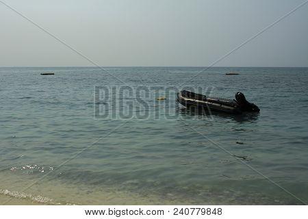 Rescue Boat In The Seaof Rescue Unit To Take Care Of Tourist In The Sea,empty Black Rubber Boat And