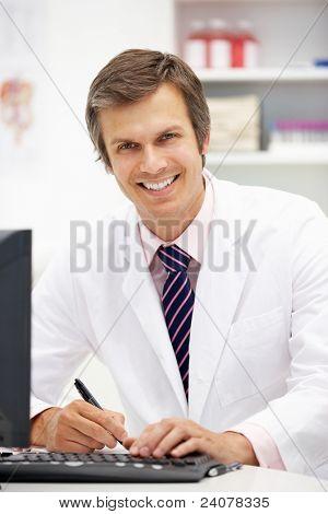 Hospital doctor at desk