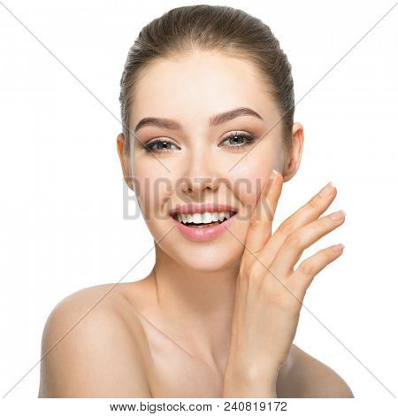 Young smiling woman with beautiful face, clean healthy skin - isolated on white. Skin care concept.