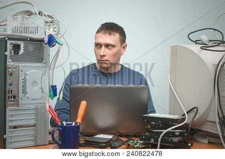 Surprised Computer Technician Works With Pc Hardware. Computer Repairman Concept.