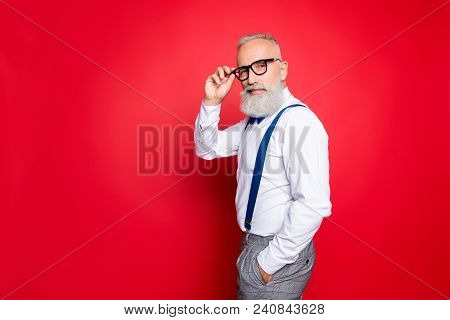 Portrait Of Cool, Manly, Fashionable Old Man Holding Hand In Pocket And Eyelet Of Glasses On His Fac