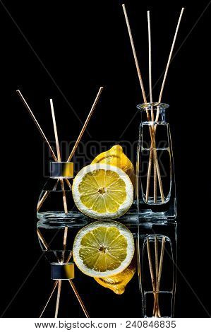 Air Fresheners With Lemon Scent In A Beautiful Glass Jars With Sticks And Whole Lemon And A Slice Of