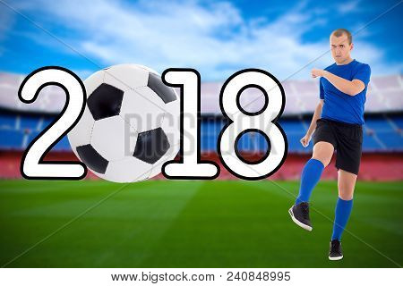 Football 2018 Concept - Young Soccer Player In Blue Uniform Kicking Ball On The Stadium
