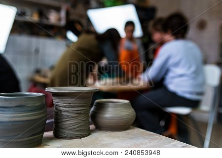 Several Kids Learn To Make Pots At Pottery Workshop