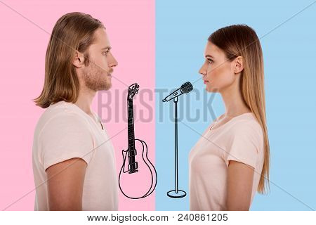 Serious Musicians. Professional Talented Musicians Looking At Each Other And Feeling Confident Befor