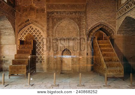Isfahan, Iran - April 22, 2018: Two Traditional Wooden Minbars In The Historic Imam Mosque At Naghsh