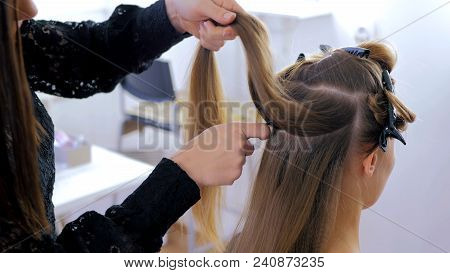 Professional Hairdresser, Stylist Combing Hair Of Female Client And Using Barrette For Fixing Hairdo