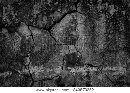 Old Cracked Black Concrete Wall. Weathered Cement Texture. Gloomy Dark Background