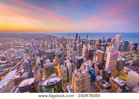 Chicago, Illinois, USA skyline from above towards Lake Michigan at dusk.