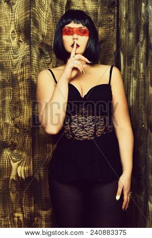 Pretty Cute Young Stylish Brunette Woman In Sexy Corset Or Underwear On Plump Body In Black Wig Posi