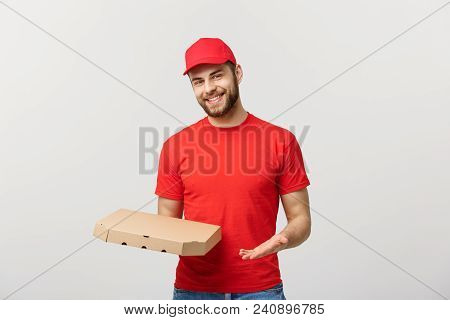Delivery Concept: Young Haapy Caucasian Handsome Pizza Delivery Man Holding Pizza Boxes Isolated Ove