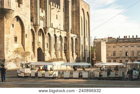 Avignon, France - October 8, 2009: People Taking Seats In Tourist Train In Front Of Papal Palace Or