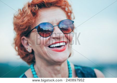 Happy Mature Woman Laughing And Enjoying Life