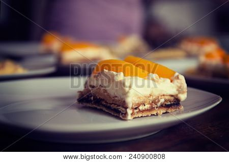 Homemade Cream Cake With Peaches, Closeup With Shallow Depth Of Field. Vignetting And Toning Effect.