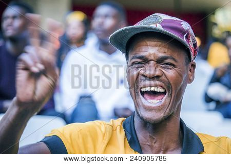 Cape Town, South Africa, 12 May 2018 - Diverse South African Football Supporter Cheering And Celebra