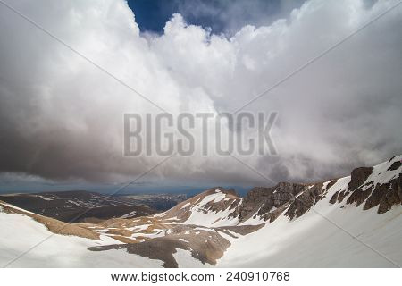 The Foothills Of The Snowy Peaks Of The High Mountain