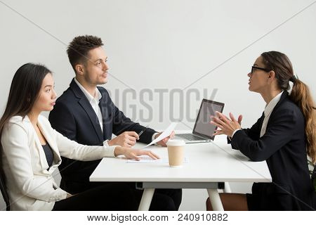 Female Job Applicant Interviewed By Two Hr Managers Reading Her Resume, Employee Talking About Exper